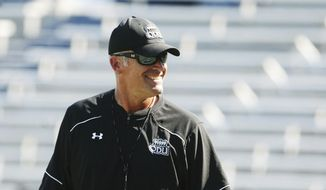 FILE - In this Aug. 29, 2015, file photo, Old Dominion University head football coach Bobby Wilder smiles during NCAA college football practice in Norfolk, Va. Old Dominion takes on North Carolina on Saturday. (AP Photo/Jason Hirschfeld. File)
