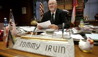 FILE - In this Jan. 28, 2009 file photo, then Georgia Commissioner of Agriculture Tommy Irvin works at his desk in Atlanta. Irvin, whose four decades in office made him one of the longest-serving statewide officials in U.S., died at the age of 88, the department he once ran confirmed Friday, Sept. 15, 2017. First appointed as state agriculture head in 1969 by then-Gov. Lester Maddox, Irvin went on to win 10 consecutive elections before deciding to retire in 2011 because of age and health reasons.  (AP Photo/John Bazemore, File)