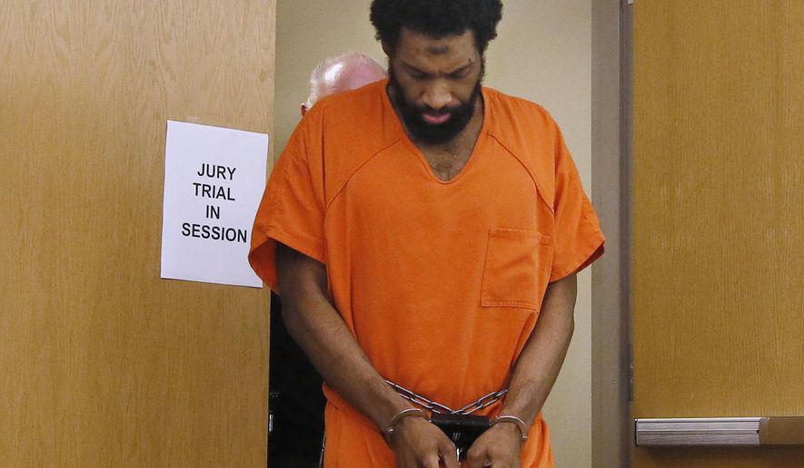 Alton Nolen, who is charged with first-degree murder in the September 2014 beheading of 54-year-old Colleen Hufford at Vaughan Foods in Moore, Okla., is led from the courtroom Monday, Sept. 11, 2017, following a morning of jury selection in his trial in Norman, Okla. (AP Photo/Sue Ogrocki)