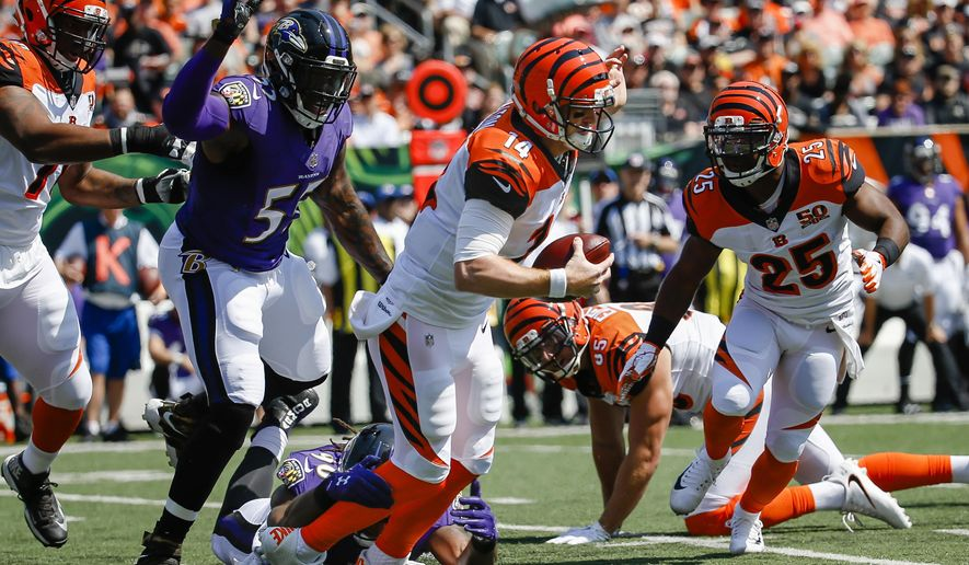 FILE - In this Sept. 10, 2017 file photo, Cincinnati Bengals quarterback Andy Dalton (14) is sacked by Baltimore Ravens outside linebacker Za'Darius Smith (90) in the first half of an NFL football game in Cincinnati. Dalton  went down five times when Baltimore blanked Cincinnati.  (AP Photo/Frank Victores)