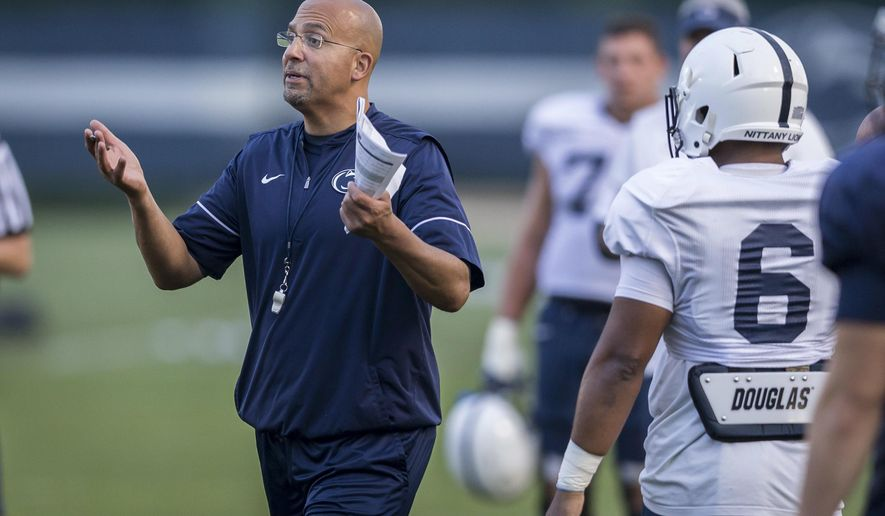 Penn State coach James Franklin talks to the team during NCAA college football practice Wednesday, Sept. 13, 2017, in State College, Pa. (Joe Hermitt/PennLive.com via AP)