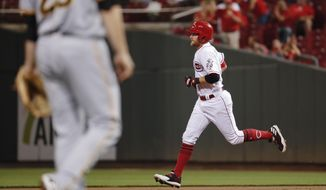 Cincinnati Reds' Zack Cozart runs the bases after hitting a solo home run off Pittsburgh Pirates starting pitcher Chad Kuhl during the third inning of a baseball game, Friday, Sept. 15, 2017, in Cincinnati. (AP Photo/John Minchillo)