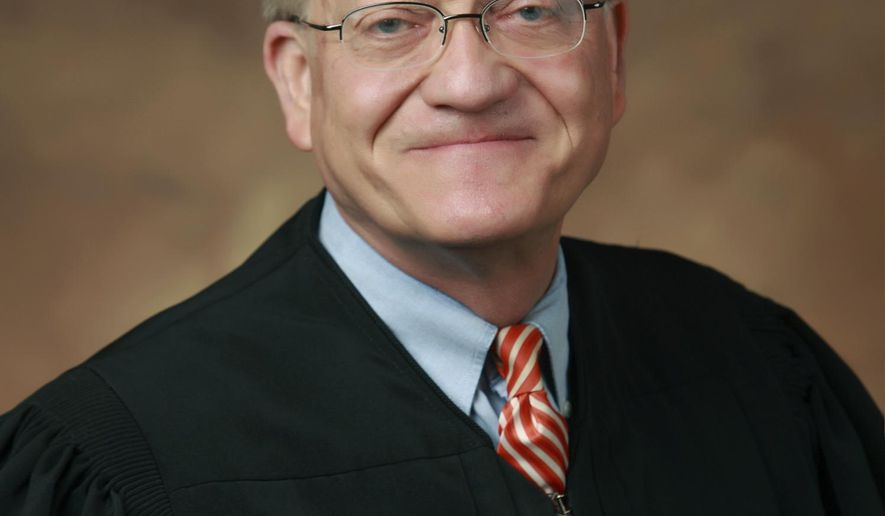 In this undated photo released by 22nd Judicial Circuit Court of Missouri, St. Louis Circuit Judge Timothy Wilson is seen. Wilson acquitted Jason Stockley, a white former St. Louis police officer Friday, Sept. 15, 2017, in the death of Anthony Lamar Smith, a black man who was fatally shot following a high-speed chase in 2011.   (22nd Judicial Circuit Court of Missouri via AP)