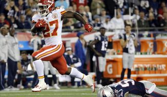 FILE - In this Thursday, Sept. 7, 2017, file photo, Kansas City Chiefs running back Kareem Hunt (27) eludes New England Patriots defensive end Cassius Marsh (55) as he runs for a touchdown after catching a pass from Alex Smith during the second half of an NFL football game in Foxborough, Mass. Of 266 rookies on active rosters in Week 1, 33 started and 13 more played at least half the snaps. Linebackers and running backs led the way with a combined total of 15 guys, including Kareem Hunt, Leonard Fournette and T.J. Watt. (AP Photo/Steven Senne, File)