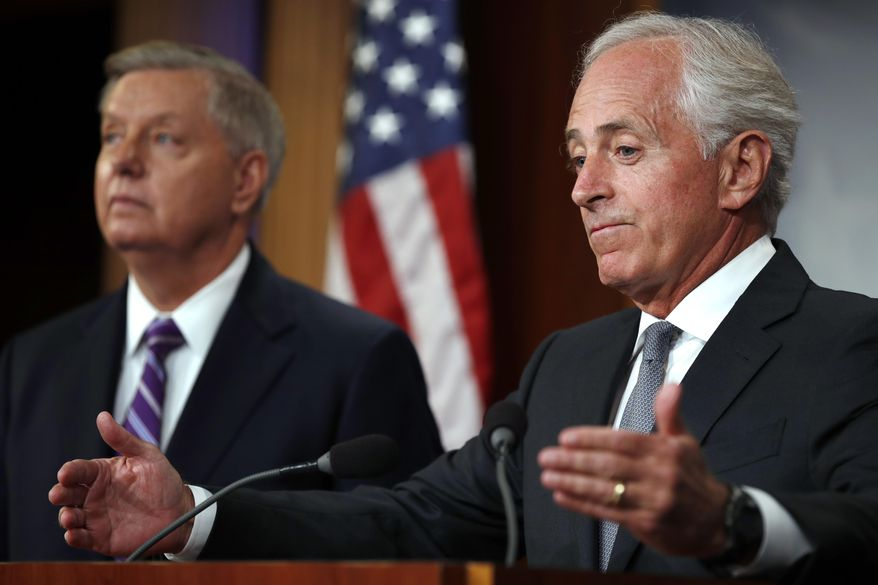 Sen. Bob Corker, R-Tenn., right, with Sen. Lindsey Graham, R-S.C., speaks at a news conference about efforts to end modern slavery, Thursday, Sept. 14, 2017, on Capitol Hill in Washington. (AP Photo/Jacquelyn Martin)