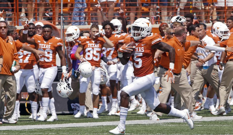 FILE - In this Sept. 2, 2017, file photo, Texas defensive back Holton Hill (5) runs a blocked field goal attempt back for a touchdown against Maryland during an NCAA college football game in Austin, Texas. Hill has emerged as a surprising scoring threat for Texas and should give Southern California quarterback Sam Darnold plenty to think about when Longhorns (1-1) and No. 4 Trojans (2-0) face off Saturday night in their first meeting since the classic 2006 Rose Bowl. (AP Photo/Michael Thomas, File)