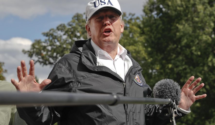 President Donald Trump answers a question from the media as he arrives at the White House, Thursday, Sept. 14, 2017, in Washington. Trump is returning from Florida after viewing damage from Hurricane Irma. (AP Photo/Alex Brandon)