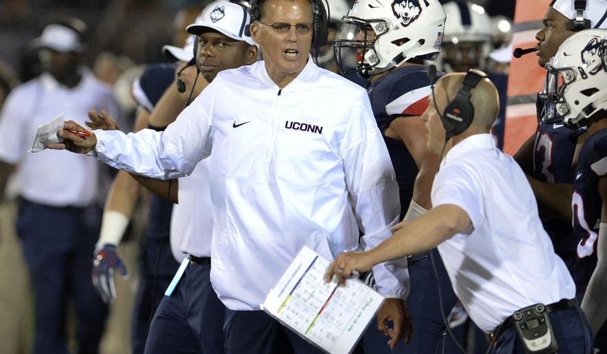 FILE - In this Thursday, Aug. 31, 2017, file photo, Connecticut head coach Randy Edsall works the sidelines during the season opening NCAA college football game against Holy Cross at Pratt & Whitney Stadium at Rentschler Field in East Hartford, Conn.. UConn takes on Virginia on Saturday. (AP Photo/Stephen Dunn, File)