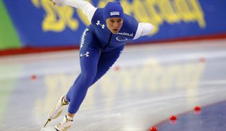 FILE - In this Feb. 28, 2016, file photo, Brittany Bowe, of the United States, skates during the ladies' 1,000-meter race of the ISU World Sprint Speed Skating Championships in Seoul, South Korea. Bowe is getting back on track at the speedskating oval after the Olympian missed time recently because of concussion symptoms. (AP Photo/Lee Jin-man, File)