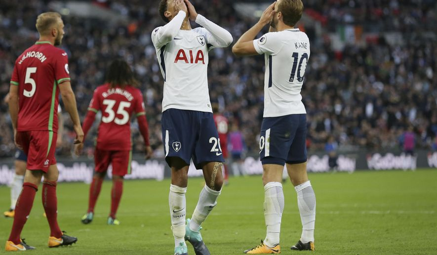 Tottenham's Dele Alli, left, and Tottenham's Harry Kane looks dejected after missed chances during the English Premier League soccer match between Tottenham Hotspur and Swansea City at Wembley stadium in London, Saturday Sept. 16, 2017. (AP Photo/Tim Ireland)
