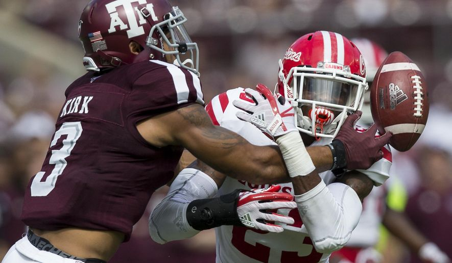Louisiana-Lafayette defensive back Tracy Walker (23) breaks up pass intended for Texas A&M wide receiver Christian Kirk (3) during the first quarter of an NCAA college football game Saturday, Sept. 16, 2017, in College Station, Texas. (AP Photo/Sam Craft)