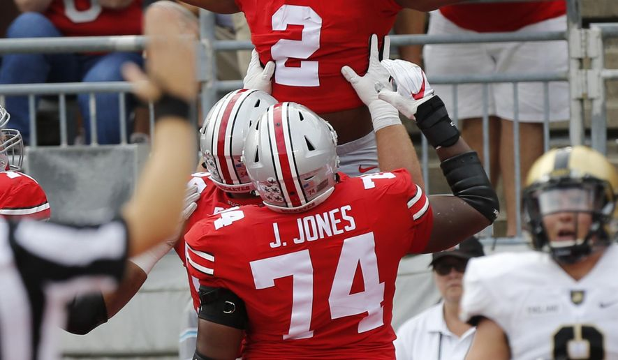 Ohio State running back J.K. Dobbins, top, celebrates his touchdown against Army during the first half of an NCAA college football game Saturday, Sept. 16, 2017, in Columbus, Ohio. (AP Photo/Jay LaPrete)
