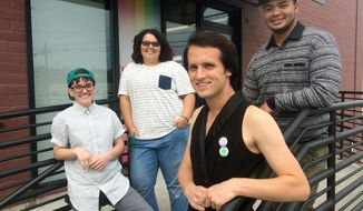 In this Sept. 9, 2017 photo, from left: Louie Borgen, 19, Skylar Robinson, 16, Timmie Flock, 23, and Theo Calhoun, 20, pose outside the LGBT youth center, in Tacoma, Wash. Washington natives soon might be able to change the gender designation on their birth certificates to one that is neither male nor female. Call it gender X or the more clinical term: non-binary. The group, all members of Tacoma's Oasis Youth Center, would welcome a non-binary gender option on Washington State birth certificates. (Craig Sailor /The News Tribune via AP)