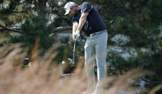 Marc Leishman strikes his tee shot on the fourth hole during the third round of the BMW Championship golf tournament at Conway Farms Golf Club, Saturday, Sept. 16, 2017, in Lake Forest, Ill. (AP Photo/Charles Rex Arbogast)