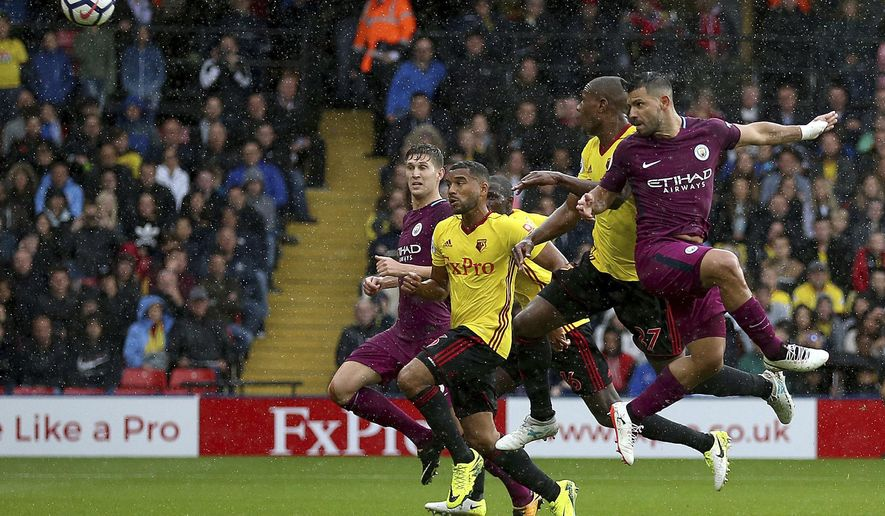 Manchester City's Sergio Aguero, right, scores his side's first goal of the game against Watford during their English Premier League soccer match at Vicarage Road in Watford, England, Saturday Sept. 16, 2017. (Nigel French/PA via AP)