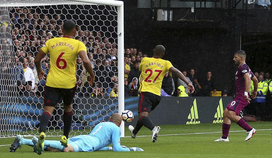 Manchester City's Sergio Aguero, right, taps in his side's second goal against Watford during their English Premier League soccer match at Vicarage Road in Watford, England, Saturday Sept. 16, 2017. (Nigel French/PA via AP)