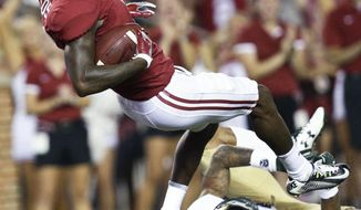 Alabama wide receiver Robert Foster falls into the end zone with a touchdown against Colorado State safety Jordan Fogal in the first half of an NCAA college football game, Saturday, Sept. 16, 2017, in Tuscaloosa, Ala. (AP Photo/Brynn Anderson)