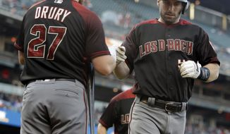 Arizona Diamondbacks' Paul Goldschmidt, right, celebrates with Brandon Drury (27) after hitting a two-run home run off San Francisco Giants pitcher Madison Bumgarner during the first inning of a baseball game Saturday, Sept. 16, 2017, in San Francisco. (AP Photo/Ben Margot)