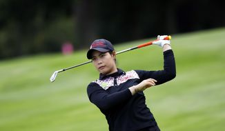 Moriya Jutanugarn, of Thailand, follows her ball after playing on the 18th hole during the second round of the Evian Championship women's golf tournament in Evian, eastern France, Saturday, Sept. 16, 2017. (AP Photo/Laurent Cipriani)