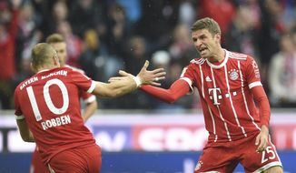 Munich's Thomas Mueller, right, and Arjen Robben celebrate their sides first goal during the first division Bundesliga soccer match between Bayern Munich and FSV Mainz 05 in Munich, Germany, Saturday, Sept. 16, 2017. (Andreas Gebert/dpa via AP)