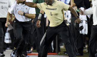 Vanderbilt head coach Derek Mason yells at an official during the first half of an NCAA college football game against Kansas State, Saturday, Sept. 16, 2017, in Nashville, Tenn. (AP Photo/Mark Zaleski)