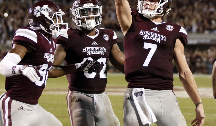 Mississippi State quarterback Nick Fitzgerald (7) celebrates his three-yard touchdown run against LSU during the first half of their NCAA college football game against in Starkville, Miss., Saturday, Sept. 16, 2017. (AP Photo/Rogelio V. Solis)