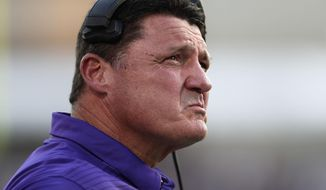 LSU head coach Ed Orgeron looks at a replay on the end zone screen during the first half of their NCAA college football game against Mississippi State in Starkville, Miss., Saturday, Sept. 16, 2017. (AP Photo/Rogelio V. Solis)