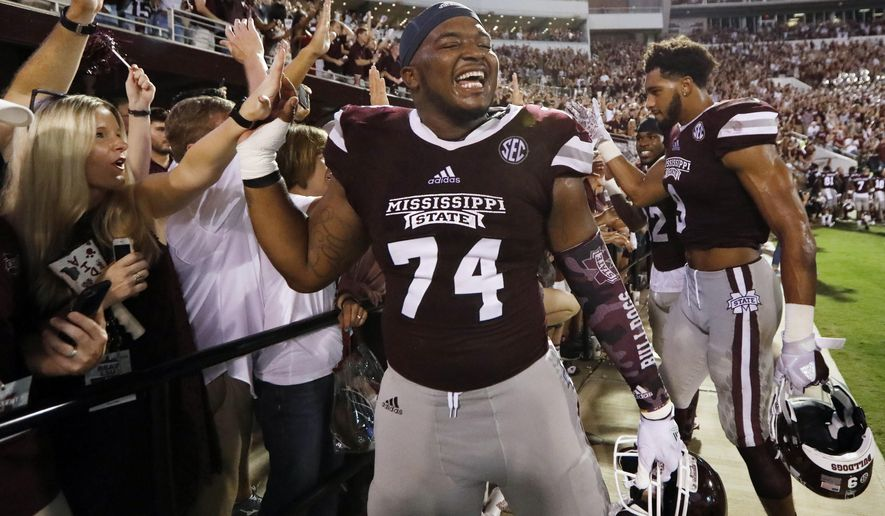 Mississippi State offensive lineman Elgton Jenkins (74) is congratulated by fans following their NCAA college football game win against LSU in Starkville, Miss., Saturday, Sept. 16, 2017. Mississippi State won 37-7. (AP Photo/Rogelio V. Solis)