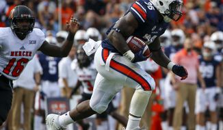 Auburn running back Kamryn Pettway (36) carries the ball during the first half of an NCAA college football game against Mercer, Saturday, Sept. 16, 2017, in Auburn, Ala. (AP Photo/Butch Dill)