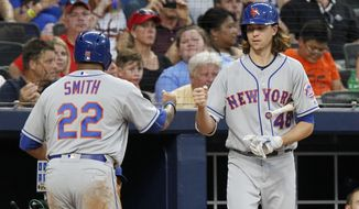 New York Mets starting pitcher Jacob deGrom (48) celebrates with Dominic Smith (22) after Smith scored during the second inning of a baseball game against the Atlanta Braves in Atlanta, Saturday, Sept. 16, 2017. (AP Photo/Tami Chappell)