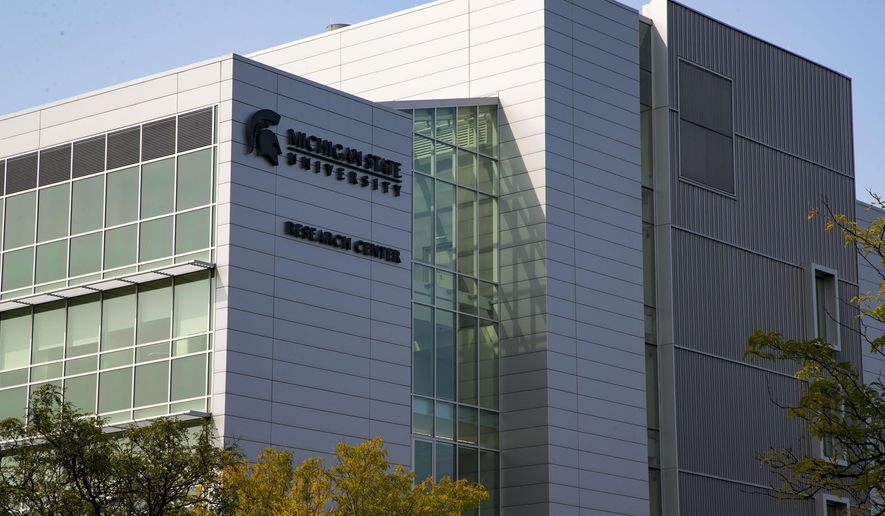 This Monday, Sept. 11, 2017 photo shows Michigan State University's new Grand Rapids Research Center in Grand Rapids, Mich. Scientists at the center will research cures and treatments for diseases such as Parkinson's, Alzheimer's and cancer. The focus will be on neuroscience, women's health science, children's health science and cancer.   (Mike Clark  /The Grand Rapids Press via AP)