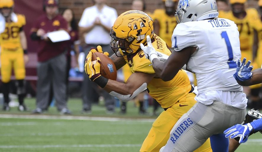 Minnesota defensive back Jacob Huff intercept a pass intended to Middle Tennessee Blue Raiders running back Shane Tucker and returns it for a touchdown in the second quarter of an NCAA college football game on Saturday, Sept. 16, 2017, in Minneapolis. (AP Photo/John Autey)