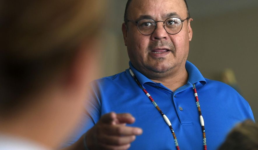 In this Thursday, Sept. 7, 2017 photo, Kevin Kickingwoman speaks to his class at Loyola Sacred Heart High School, in Missoula, Mont., where he is in his second year teaching Native American Studies. The course is now required for seniors at the Catholic high school. (Tommy Martino /The Missoulian via AP)