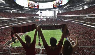 Atlanta United fans cheer for their team before an MLS soccer match against the Orlando City, Saturday, Sept. 16, 2017, in Atlanta. (Hyosub Shin/Atlanta Journal-Constitution via AP)
