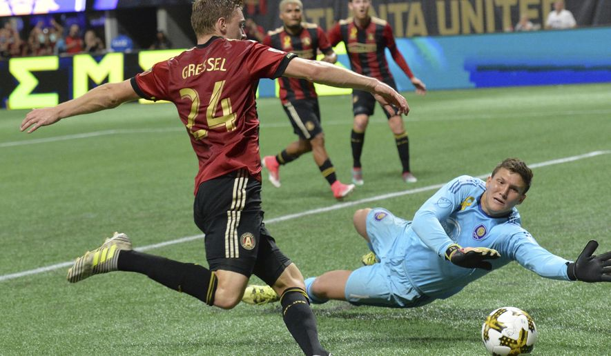 Atlanta United defender Julian Gressel (24) scores past Orlando City SC goalkeeper Joseph Bendik (1) in the first half of an MLS soccer match, Saturday, Sept. 16, 2017, in Atlanta. (Hyosub Shin/Atlanta Journal-Constitution via AP)