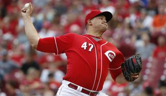 Cincinnati Reds starting pitcher Sal Romano throws in the first inning of a baseball game against the Pittsburgh Pirates, Saturday, Sept. 16, 2017, in Cincinnati. (AP Photo/John Minchillo)