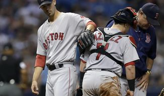Boston Red Sox starting pitcher Rick Porcello, left, pats catcher Christian Vazquez on the back after being taken out of the baseball game by manager John Farrell, right, during the eighth inning against the Tampa Bay Rays on Saturday, Sept. 16, 2017, in St. Petersburg, Fla. (AP Photo/Chris O'Meara)