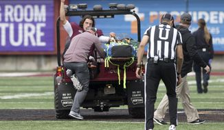 Montana quarterback Reese Phillips (11) acknowledges the crowd as he is being taken off the field on a cart after an injury against Savannah State in an NCAA college football game Saturday, Sept. 16, 2017, in Missoula, Mont. (AP Photo/Patrick Record)