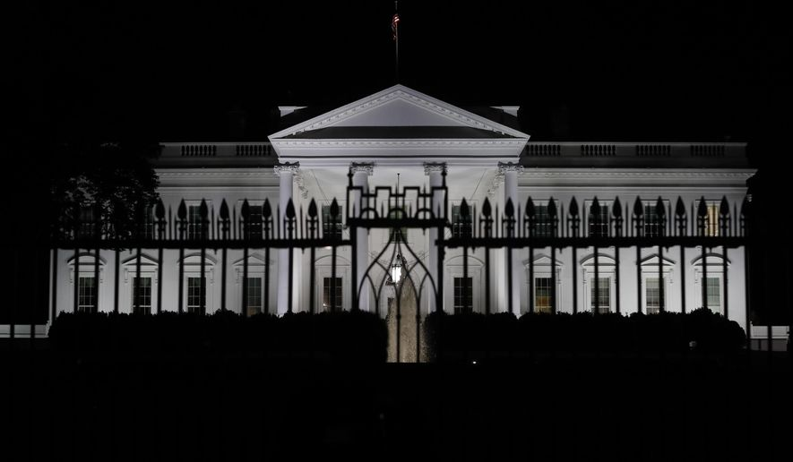 ADVANCE FOR USE SUNDAY, SEPT. 17, 2017 AND THEREAFTER-This Tuesday night, May 9, 2017 photo shows the White House in Washington. Seven months into his presidency, Donald Trump still refuses to divest from his real estate and hotel empire or release virtually any of his tax returns. His administration is vigorously pursuing whistleblowers. (AP Photo/Carolyn Kaster)
