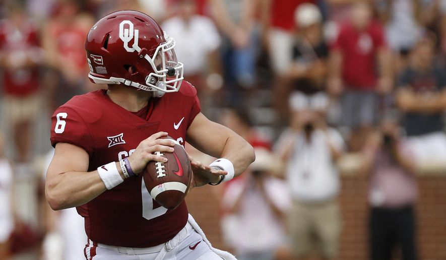 Oklahoma quarterback Baker Mayfield (6) looks for a receiver before throwing a touchdown pass against Tulane during the first quarter of an NCAA college football game in Norman, Okla., Saturday, Sept. 16, 2017. (AP Photo/Mitch Alcala)