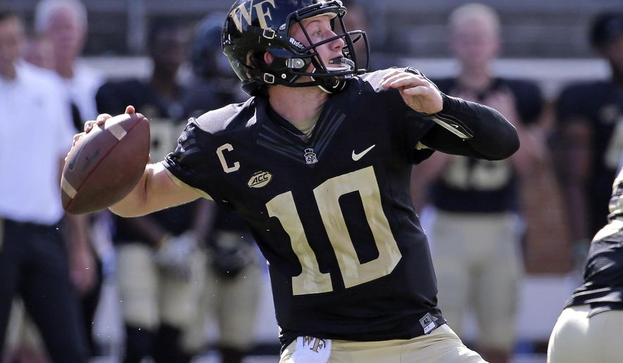 Wake Forest's John Wolford (10) looks to pass against Utah State in the first half of an NCAA college football game in Winston-Salem, N.C., Saturday, Sept. 16, 2017. (AP Photo/Chuck Burton)