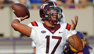 Virginia Tech's Josh Jackson (17) delivers a pass during the second half of an NCAA college football game against East Carolina in Greenville, N.C., Saturday, Sept. 16, 2017. (AP Photo/Karl B DeBlaker) ** FILE **