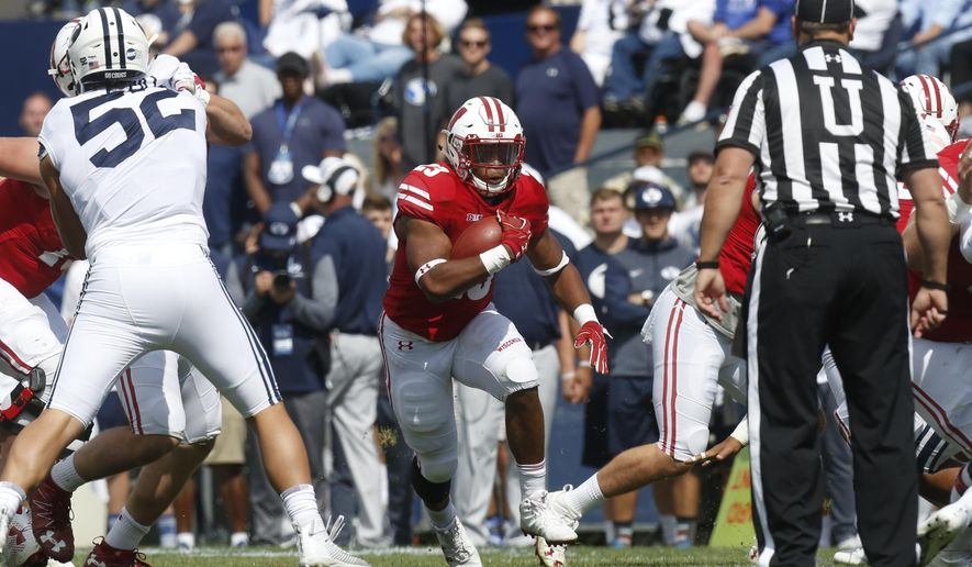 Wisconsin running back Jonathan Taylor (23) runs the ball in the first half during an NCAA college football game against BYU, Saturday, Sept. 16, 2017, in Provo, Utah. (AP Photo/Kim Raff)