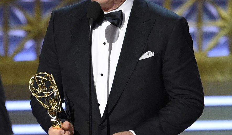 """Alec Baldwin accepts the award for outstanding supporting actor in a comedy series for """"Saturday Night Live"""" at the 69th Primetime Emmy Awards on Sunday, Sept. 17, 2017, at the Microsoft Theater in Los Angeles. (Photo by Chris Pizzello/Invision/AP)"""