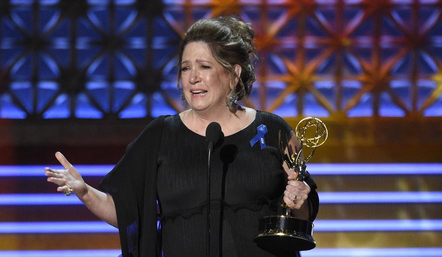 Ann Dowd accepts the award for outstanding supporting actress in a drama series for 'The Handmaid's Tale' at the 69th Primetime Emmy Awards on Sunday, Sept. 17, 2017, at the Microsoft Theater in Los Angeles. (Photo by Chris Pizzello/Invision/AP)