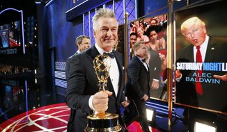 "IMAGE DISTRIBUTED FOR THE TELEVISION ACADEMY - Alec Baldwin, winner of the award for outstanding supporting actor in a comedy series for ""Saturday Night Live"", left, walks with James Corden on the red carpet stage at the 69th Primetime Emmy Awards on Sunday, Sept. 17, 2017, at the Microsoft Theater in Los Angeles. (Photo by Danny Moloshok/Invision for the Television Academy/AP Images)"