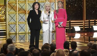Lily Tomlin, from left, Dolly Parton, Jane Fonda speak at the 69th Primetime Emmy Awards on Sunday, Sept. 17, 2017, at the Microsoft Theater in Los Angeles. (Photo by Phil McCarten/Invision for the Television Academy/AP Images)