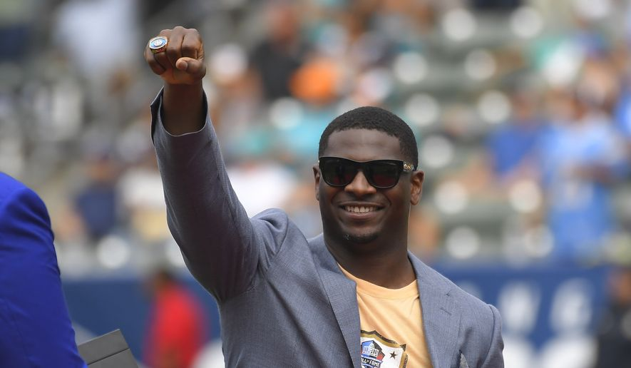 Former Chargers running back LaDainian Tomlinson receives his Pro Football Hall of Fame ring during a halftime ceremony in an NFL football game against the Miami Dolphins and the Los Angeles Chargers Sunday, Sept. 17, 2017, in Carson, Calif. (AP Photo/Mark J. Terrill)