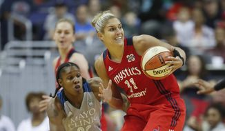 Washington Mystics guard Elena Delle Donne (11) goes against Minnesota Lynx forward Rebekkah Brunson (32) during the first half of Game 3 of the WNBA basketball semifinals, Sunday, Sept. 17, 2017, in Washington. (AP Photo/Pablo Martinez Monsivais) **FILE**