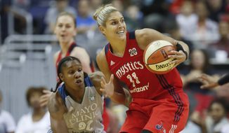 Washington Mystics guard Elena Delle Donne (11) goes against Minnesota Lynx forward Rebekkah Brunson (32) during the first half of Game 3 of the WNBA basketball semifinals, Sunday, Sept. 17, 2017, in Washington. (AP Photo/Pablo Martinez Monsivais)
